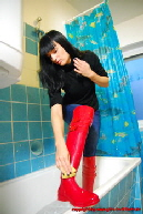 Jenice in red Calvin Klein Rubber boots